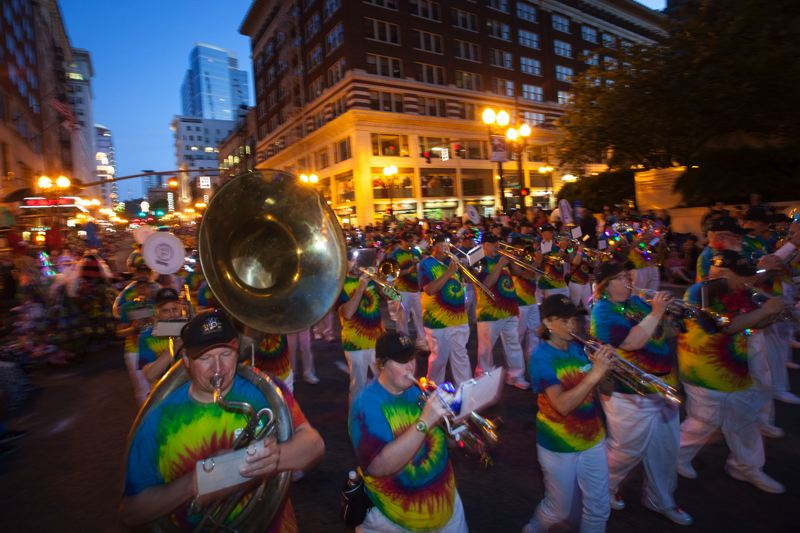 by: TRIBUNE PHOTO: JEFFREY BALL - That sounds like 'Louie, Louie.' The One More Time Around Marching Band, complete with dozens of former members, played their way along the streets behind Grand Marshal former Mayor Bud Clark during the Starlight Parade.