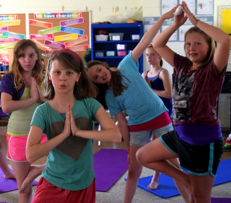 by: CONNECTION PHOTO: DREW DAKESSIAN - Students in Kim Davies' Girls Rock Yoga class at Rieke Elementary School demonstrate the poses they've learned.
