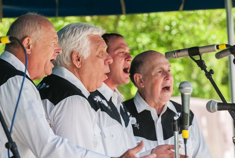 by: SPOKESMAN PHOTO: JOSH KULLA - Oregons New History Minstrels, a barbershop-style a cappella group, perform songs of Oregon history Saturday at the Wilsonville Festival of Arts.