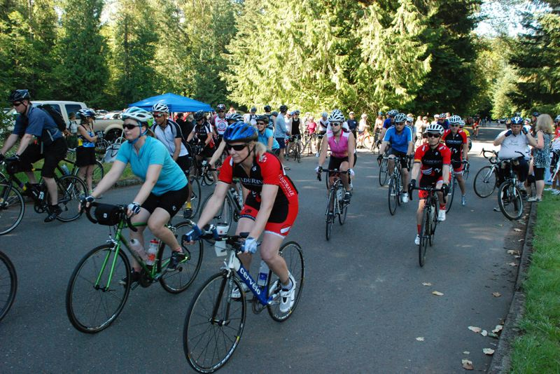 by: PHOTO BY: DAVE KLEINKE - Participants get started at Milo McIver Park for the Clackamas River Basin Council's annual Tour de Clack, an environmentally themed bicycle ride through the Clackamas watershed.