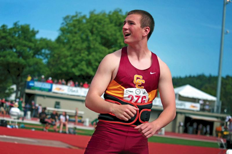 by: TRIBUNE PHOTO: JONATHAN HOUSE - John Nizich , a Central Catholic senior, takes first place in the 6A javelin on the final day of the three-day state track and field championships.