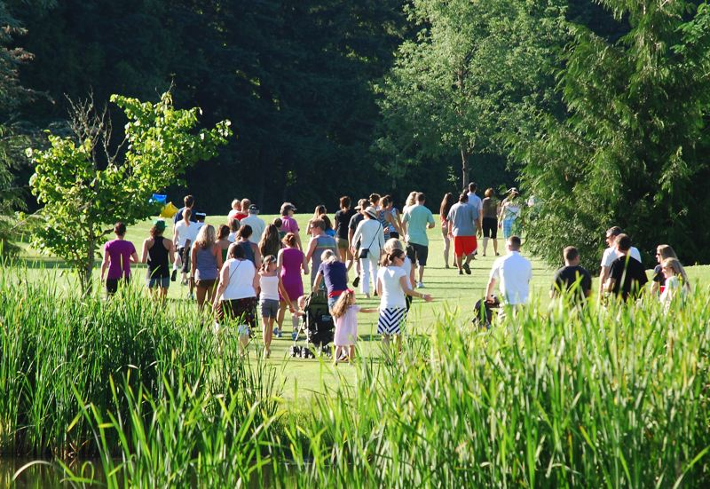 by: SUBMITTED PHOTO: COURTNEY TIMM - Walkers march around Sandelie West Nine Golf Course last year in the first annual Beths Walk For Melanoma. This years event is set for June 7.