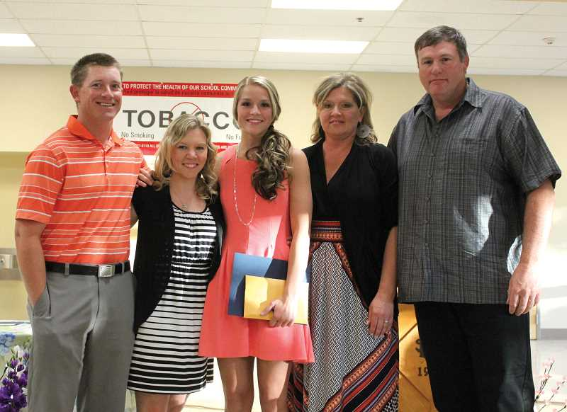 by: JEFF WILSON/THE PIONEER - Coaches Nick and Randi Viggiano join Gabrielle Alley and her parents Tammy and J.D. during Thursday night's Honors Convocation at Culver High School.