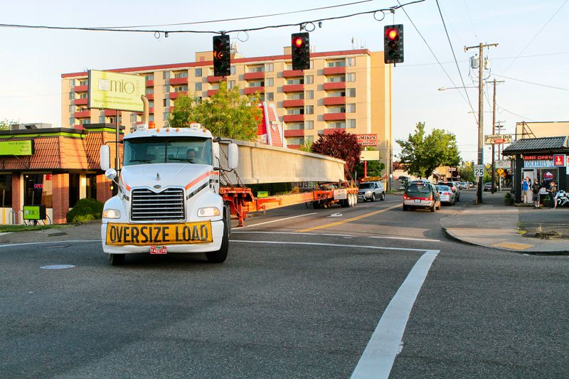 by: DAVID F. ASHTON - This driver deftly maneuvers his long load through the tight intersection of S.E. 17th Avenue and Tacoma Street.