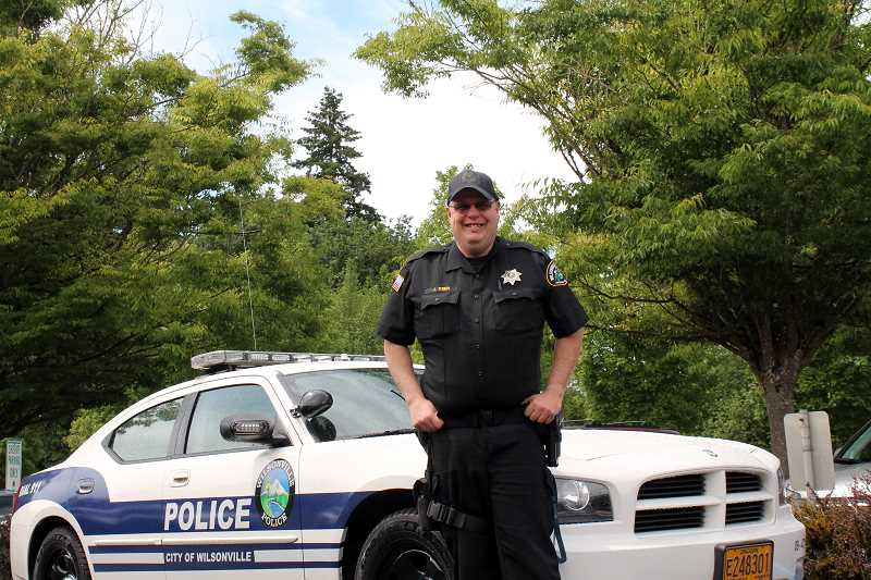 by: SPOKESMAN PHOTO: KATE HOOTS - Officer Jim Keen has parked his cruiser in this spot, marked Sheriff Parking Only, for the past nine years while serving as Wilsonville's school resource officer.