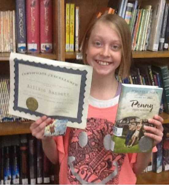by: SUBMITTED PHOTO - Carus Elementary School's Allison Bassett, a fifth-grader, recently was honored through the Letters About Literature program for her letter to author Jennifer Holm.