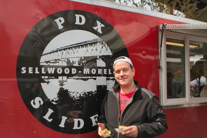 by: DAVID F. ASHTON - Ryan Rollins of PDX Sliders in Sellwood was a popular guy, as he handed out samples of the specialty he calls The Broadway at the OMSI food cart fair.