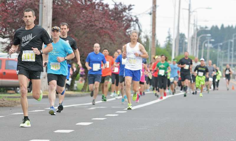 by: SPOKESMAN PHOTO: J. BRIAN MONIHAN - Runners took over the streets of Wilsonville June 1 For the Love of Schools.