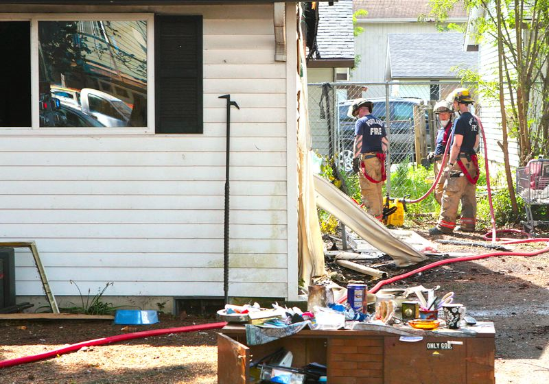 by: DAVID F. ASHTON - Fire crews check the unit next door to the burned duplex unit to make sure the fire didnt spread.