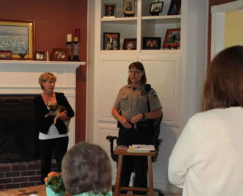 by: TIDINGS PHOTO: PATRICK MALEE - West Linn Police Community Service Officer Peggy Jones stopped by a River Heights area home last week to discuss forming a neighborhood watch group.