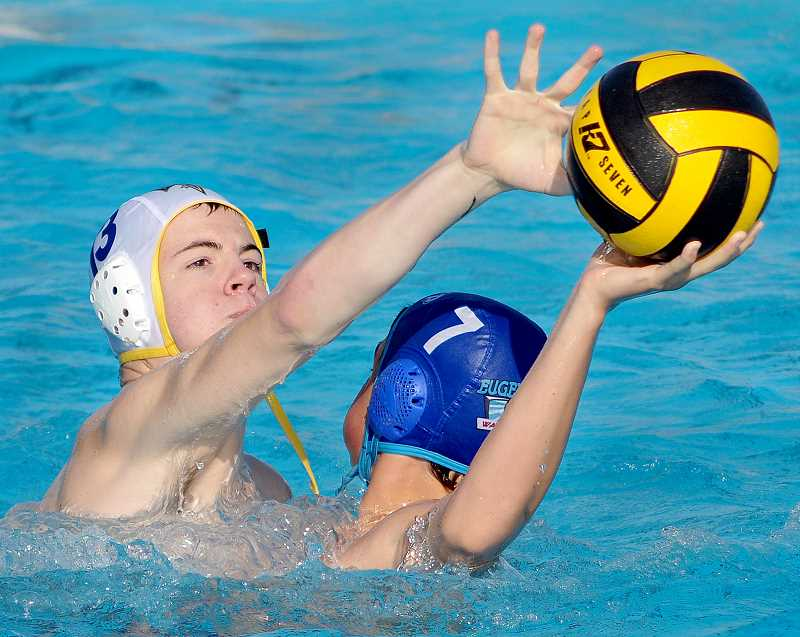 by: GARY ALLEN - Stalwart defense - Cameron Kisling applies defensive pressure in Chehalem's win over Eugene City Water Polo Saturday afternoon during the Oregon Spring League Championship.