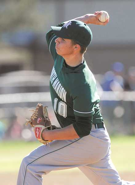 by: RYAN BRENNECKE, BEND BULLETIN - Senior Brock Breshears pitched five innings for the Huskies but was unable to contain the Sisters bats, which tagged him for 11 hits and six earned runs.