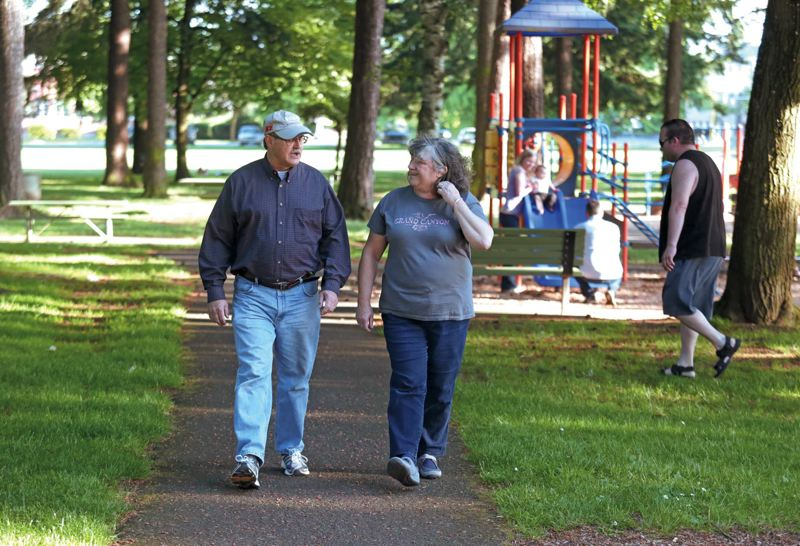 by: TRIBUNE PHOTO: JONATHAN HOUSE - Joseph and Kathy Goertz take an evening walk in Normandale Park, where theyre concerned that Saturday's Naked Bike Ride will be seen by local children.