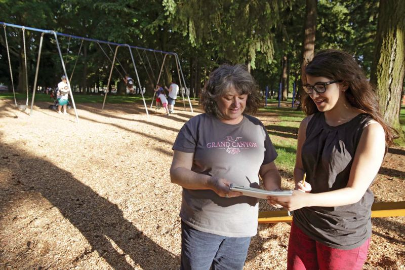 by: TRIBUNE PHOTO: JONATHAN HOUSE - Kathy Goertz looks at the artwork of family friend Sylvia Horvath at the playground of Normandale Park. Goertz is worried about Saturday's Naked Bike Ride event, which begins at the park.