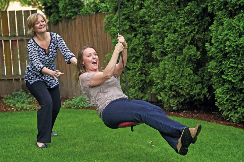 by: TRIBUNE PHOTO: JAIME VALDEZ - Lorretta Krautscheid pushes her sister, Karen Jackson, at Krautscheid's home in Beaverton. Krautscheid didn't push Jackson to take a test for the BRCA breast cancer gene that runs in their family and Jackson put off testing for 10 years.