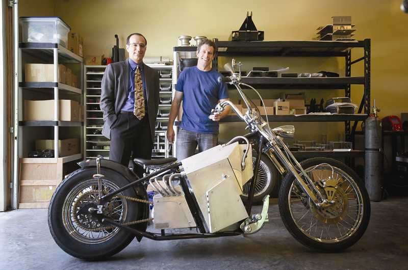 by: TIMES PHOTO: JONATHAN HOUSE - Works Electric founder Brad Baker, right, and head of business development William Lambson show off Baker's all-electric motorcycle.
