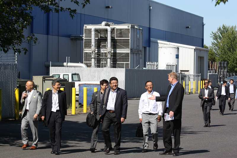 by: DOUG BURKHARDT - Business officials from Japan visited Hillsboro Friday to learn about potential opportunities to locate their manufacturing firms in the area. Here, the group is seen on a tour of the Tokai Carbon, Inc., company. Read more about the visit in the June 13 issue of the Hillsboro Tribune!