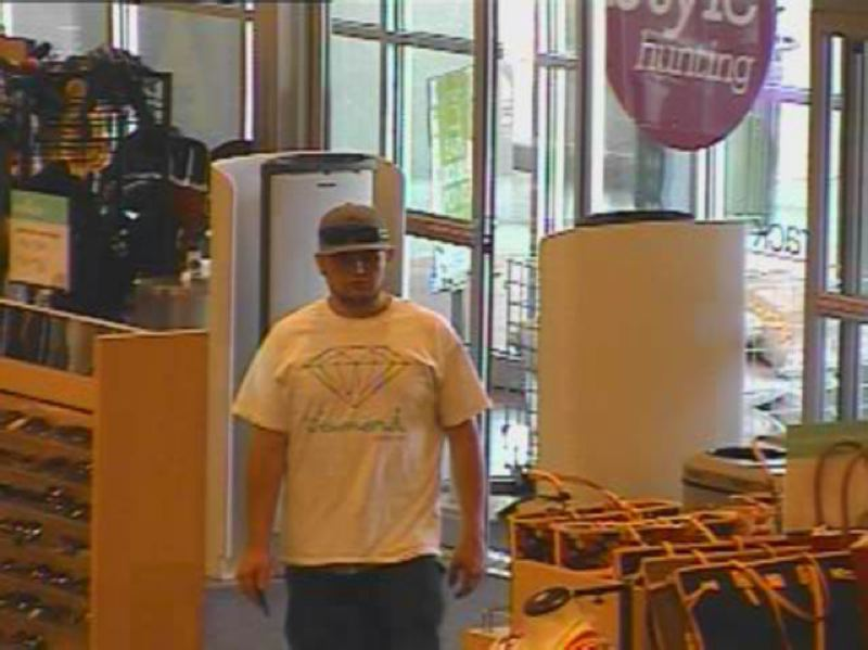 by: WILSONVILLE POLICE DEPARTMENT - Wilsonville Police suspect this man is one of two people who broke into a car at Town Center Park and used the victim's credit cards fraudulently at businesses in Tualatin and Tigard.