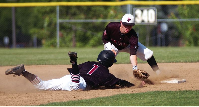 by: PAMPLIN MEDIA GROUP: DAN BROOD - Sandy senior shortstop Bryce Tilton tags out Sherwood senior Beau Curtiss on a pickoff play.