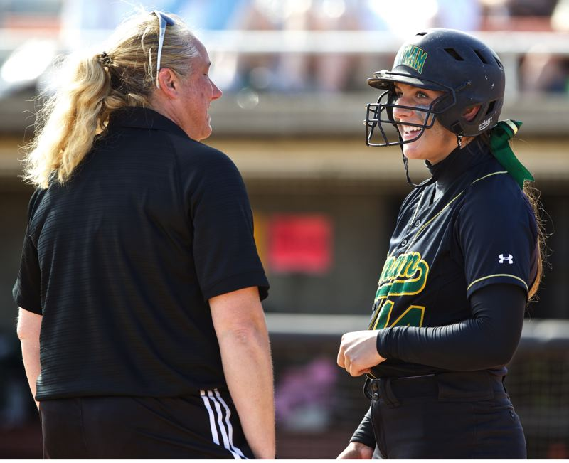 by: JAIME VALDEZ - Putnam senior Ashley Culp receives some advice from coach Tiffany Strnad prior to her fourth-inning at bat. It was Culps fourth-inning line-drive single to left that scored junior Kate Betschart.