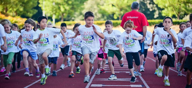 by: SPOKESMAN FILE PHOTO: JOSH KULLA - Wilsonville Kiwanis Kids Fun Run participants start a race at the 2013 event held at Wilsonville High School. This years event moves back to Wood Middle School because of work being done on the high school track.