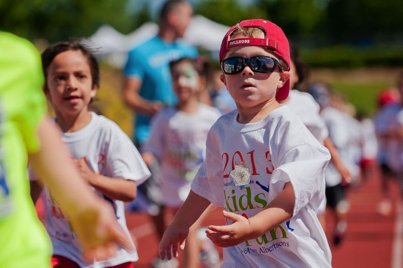 by: SPOKESMAN FILE PHOTO: JOSH KULLA - Wilsonville Kiwanis Kids Fun Run runners head toward the finish line during the 2013 event.