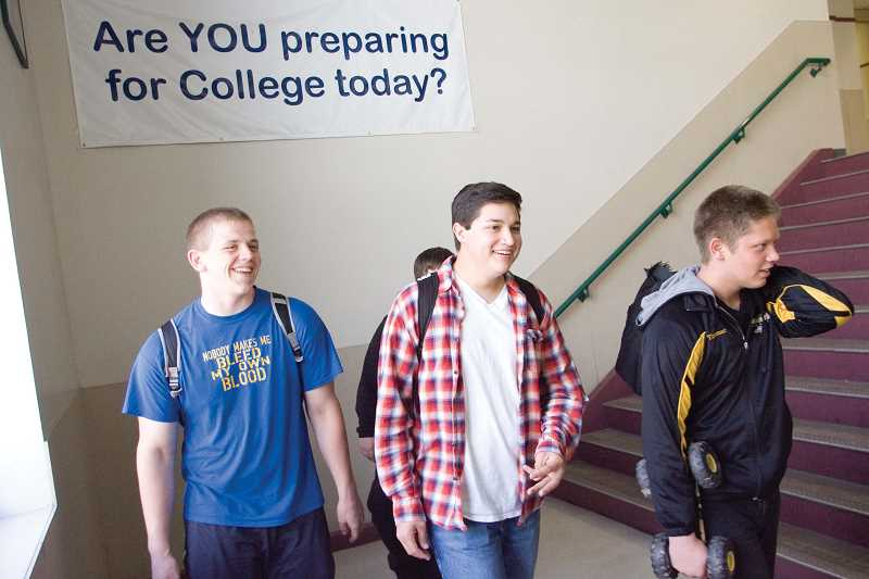 by: KEVIN SPERL - Everyday, students at Crook County High School see this sign on their way to class, reminding them to stay focused on their future. From left: Junior Trevor Rasmussen, Sophomore Blake Lopez and Junior Robbi Timmer.