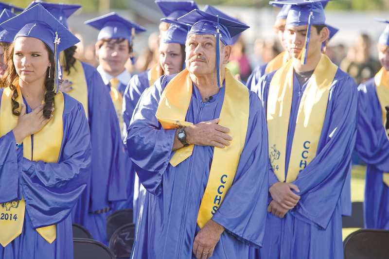 by: KEVIN SPERL - Andy Post, Class of 1966, took part in the Class of 2014 graduation at Ward Rhoden Stadium Friday night.