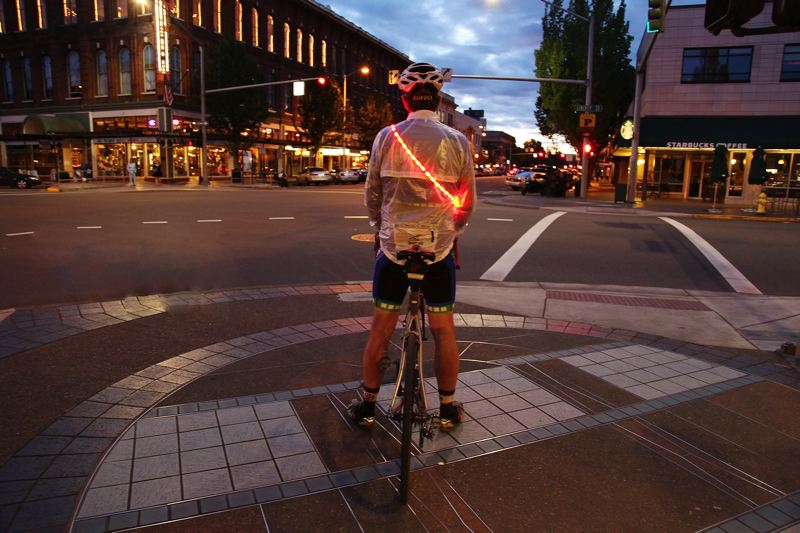 by: COURTESY OF LUMAGLO - A Portland bicyclist uses a LumaGlo Beacon.