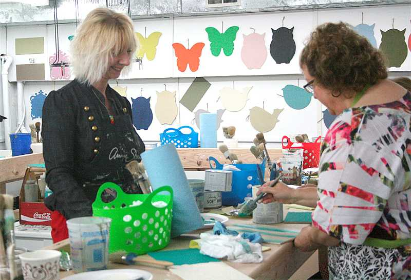 by: RACHEL ALDRICH - Cheryl Frampton (left) works with a customer during a recent class.