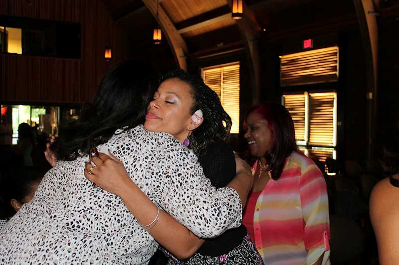 by: NEWS-TIMES PHOTO: JOANN BOATWRIGHT - Melissa Lowery of Hillsboro greeted guests who attended the first showing of her film Black Girl in Suburbia Saturday.