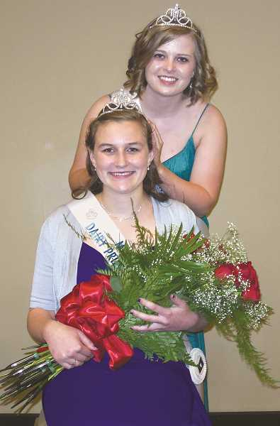 by: SUBMITTED PHOTO - Royalty --- 2014 Marion County dairy princess and ambassador Sara Pierson is crowned by Jessica Brawley, the 2013 princess/ambassador.