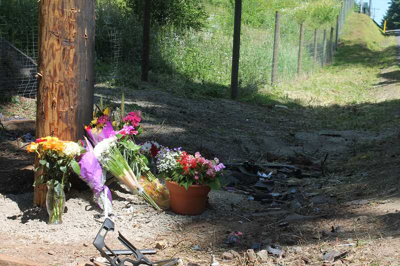 by: TIDINGS PHOTO: PATRICK MALEE - A memorial was set up at the crash site on Petes Mountain Road.