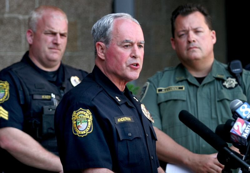 by: OUTLOOK PHOTO: JIM CLARK - Troutdale police chief  Scott Anderson releases the name of the Reynolds High School shooter at a press conference held at the Troutdale police station on Wednesday, June 11.