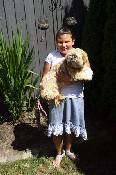 by: POST PHOTO: KYLIE WRAY - Isabelle said she loves her Lhasa Apso, Chloe. They are always hanging out together.