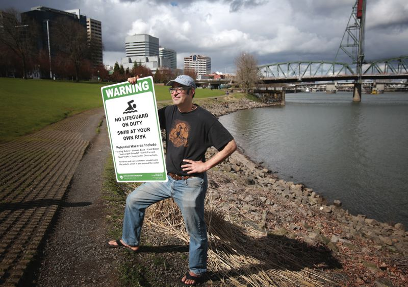 by: PAMPLIN MEDIA GROUP: JONATHAN HOUSE  - Willie Levenson, ringleader of the Human Access Project, partnered with the city parks bureau to install new, larger warning signs at  Waterfront Park north of RiverPlace. Levenson hopes the signs will promote more swimming at the small beach there.