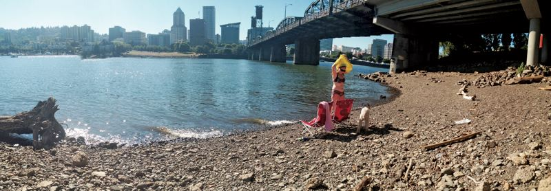 by: PAMPLIN MEDIA GROUP: - Pamela Levenson lounges at the partially cleared waterfront site opposite Gov. Tom McCall Waterfront Park that her husband Willie hopes to convert into a beach named after McCalls wife Audrey.