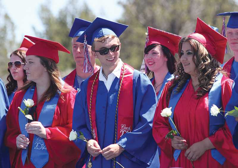 by: HOLLY M. GILL - MHS seniors, from left, Chelsea Gregory, Paige Kilby, Ian Goodwin, Anthony Otter, Tristine Culpus, Perla Penaloza and Raymond Hill await the graduation ceremony on Saturday at JCMS.