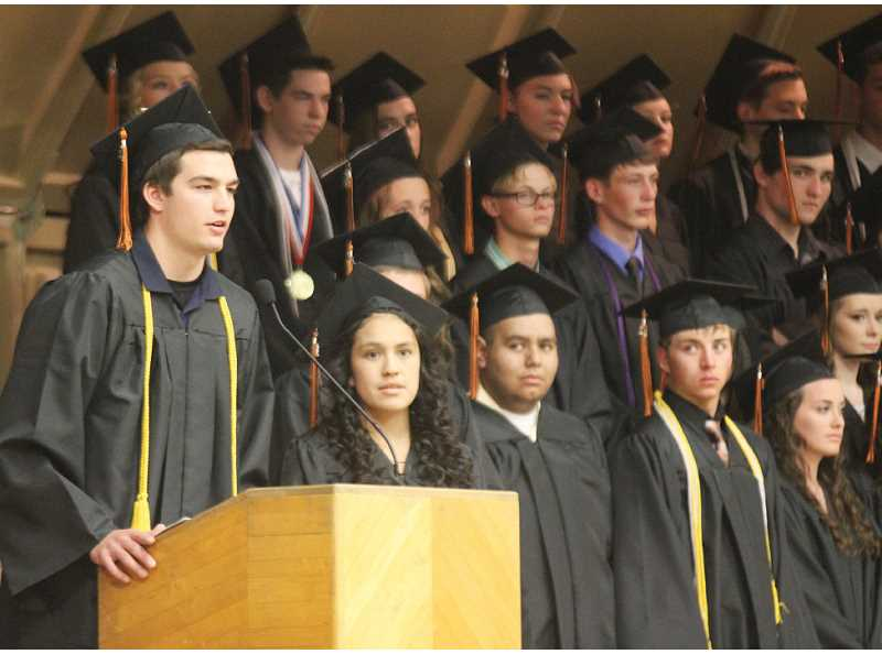 by: JEFF WILSON - Mitchell Adams, left, and Ana Badillo give the welcome at Culver High School's commencement ceremony on Saturday. CHS graduated 53 students - the most ever.