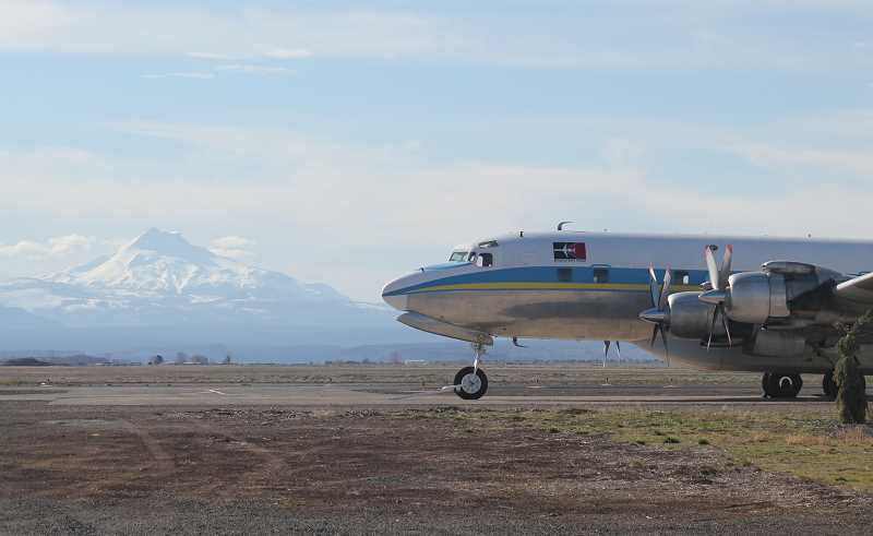 by: HOLLY M. GILL - One of the MD-87s is ready for deployment, parked at the Madras Municipal Airport with Mount Jefferson in the background, earlier this year.