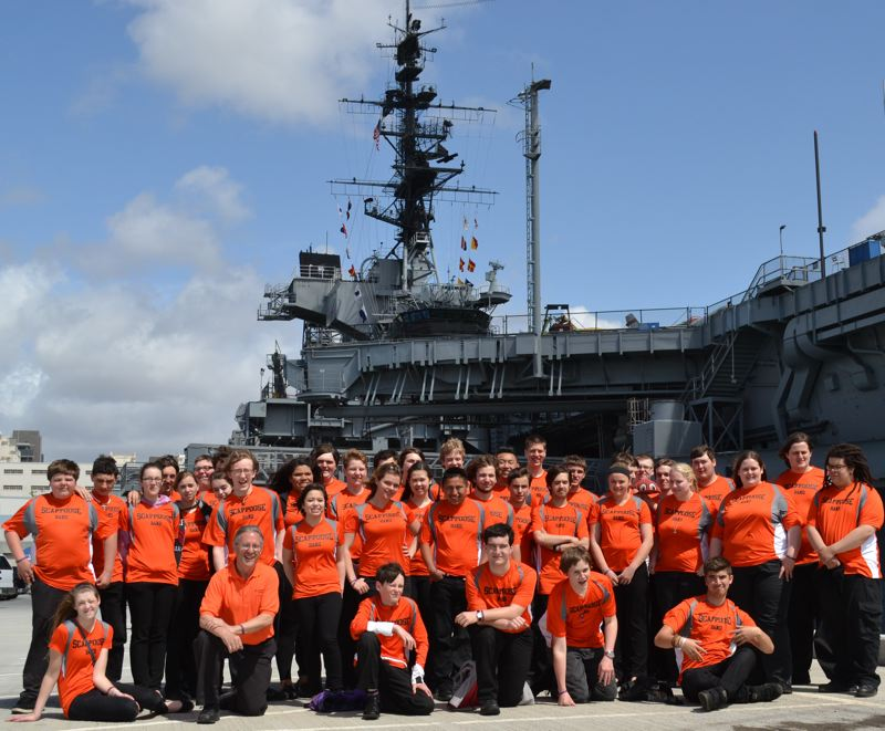 by: PHOTO COURTESY OF LARRY JACKSON - The Scappoose High School Symphonic Band, pictured before the U.S.S. Midway in San Diego during a spring school trip.