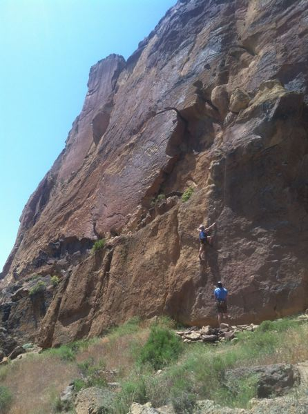 by: SPOTLIGHT PHOTO: ROBIN JOHNSON - A climber scales the face of one of Smith Rock's sport routes off the Misery Ridge trail.