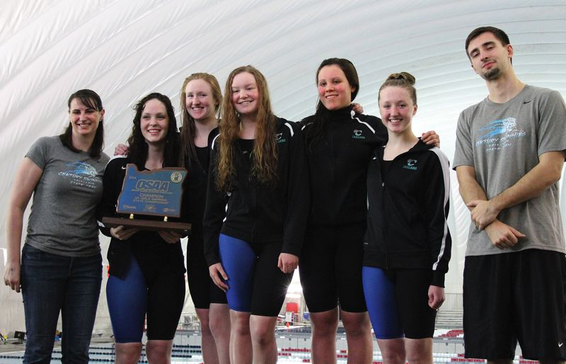 by: HILLSBORO TRIBUNE PHOTO: AMANDA MILES - Century swimming coach Sarah Holman (far left) poses with swimmers Ellie Thornbrue, Logan Neal, Hannah Galbraith, Sara Metzsch and Riley Neal, plus assistant coach Ty Gantt, after the Jaguars won a state title.