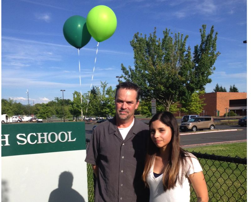 by: OUTLOOK PHOTO: LISA K. ANDERSON - Hoffman family spokesman Randy Olson and 2008 Reynolds High graduate Daniela Makowski stand at a makeshift memorial outside the school. Makowski didnt know the Hoffman family but was spurred to raise money for funeral expenses.