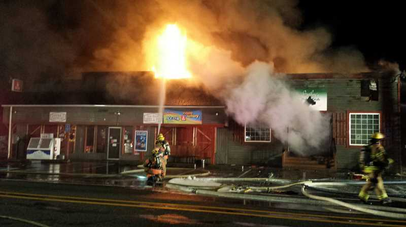 by: CONTRIBUTED - Estacada Rural Fire District No. 69 responded to a three-alarm fire at Bailey's Pub & Grub and Currinsville Store shortly after midnight on Saturday, June 14.