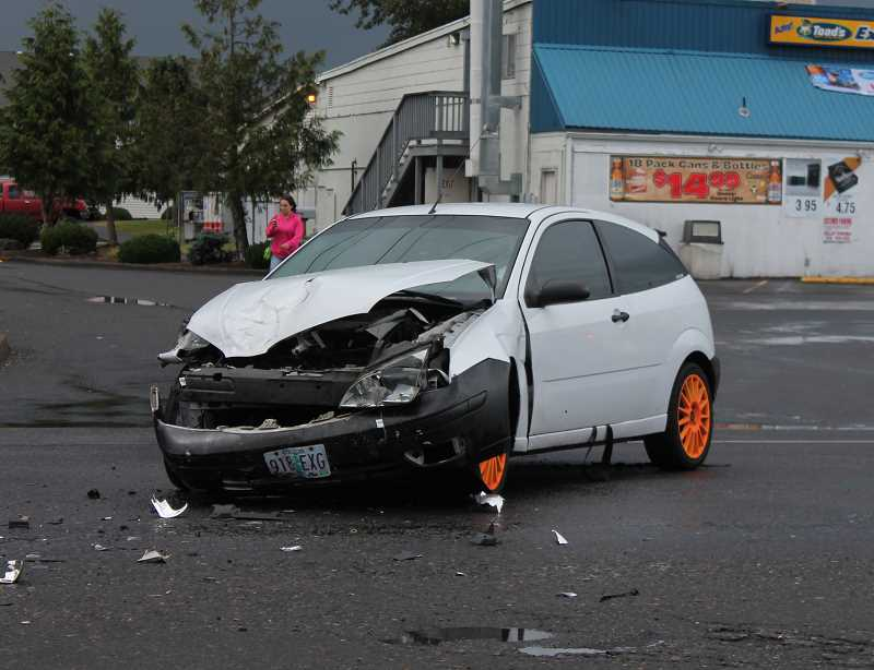 by: JIM BESEDA/MOLALLA PIONEER - The driver of this Ford Focus ZX3 was taken away by ambulance after colliding with a Chevy pick-up truck about 5:10 p.m. Monday in front of Y-Market/Toad's Express Deli at 901 E. Main St., in Molalla.
