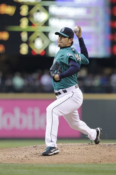 by: COURTESY OF SEATTLE MARINERS - Hisashi Iwakuma has become a mainstay in the rotation for the Seattle Mariners. In nine starts, the 33-year-old from Tokyo is 5-3 with a 2.59 ERA.