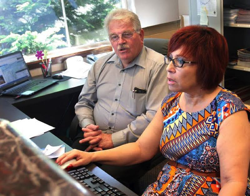 by: OUTLOOK PHOTO: JIM CLARK - MHCC hospitality and tourism students Darrel Pearce and Loni Smith work on the membership database during their internship with West Columbia Gorge Chamber of Commerce & Visitor Center. Pearce graduated last weekend and dreams of becoming an independent travel agent, focused on helping people with disabilities.