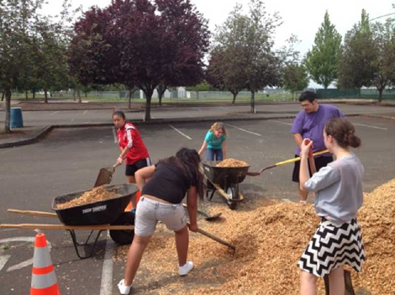 by: SUBMITTED - WAAST volunteers work on beautifying Centennial Park recently.