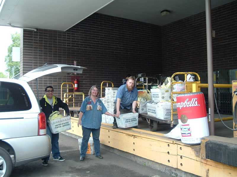 by: SUBMITTED - Local letter carriers and volunteers unload a vehicle of donated food May 10.